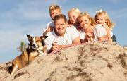 Family on beach with dog