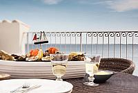 terrace beautiful view diner chairs table glass wine bread pain food seafood eat lunch manger south of france