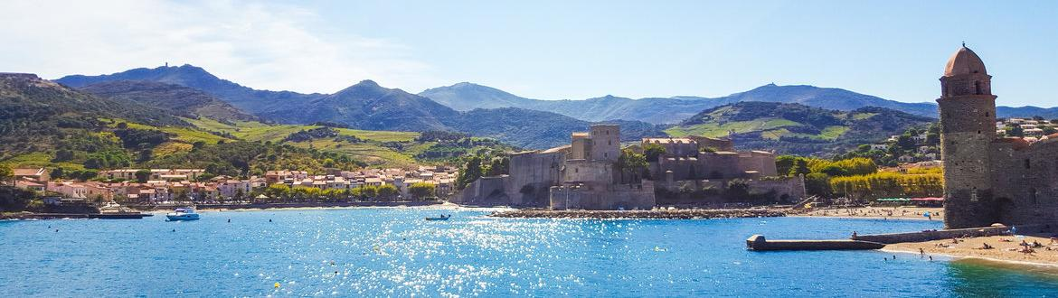 Beautiful view on the bay of Collioure with Pyrenees in the background