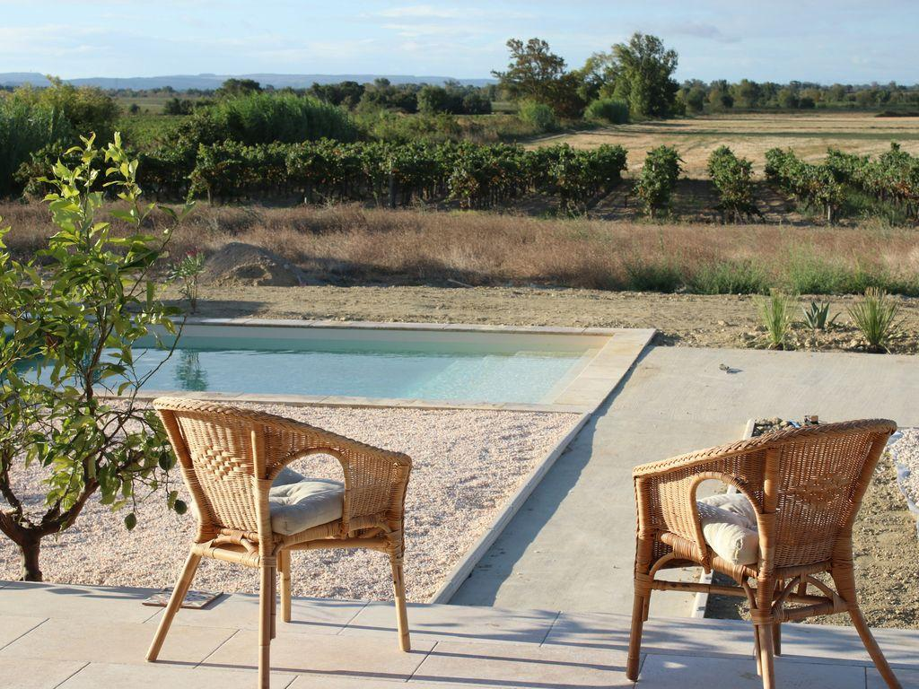 Beautiful modern gite located in Capestang in the Languedoc with a private swimming pool and stunning views. 5 bedrooms, sleeps 10. (CAP113)