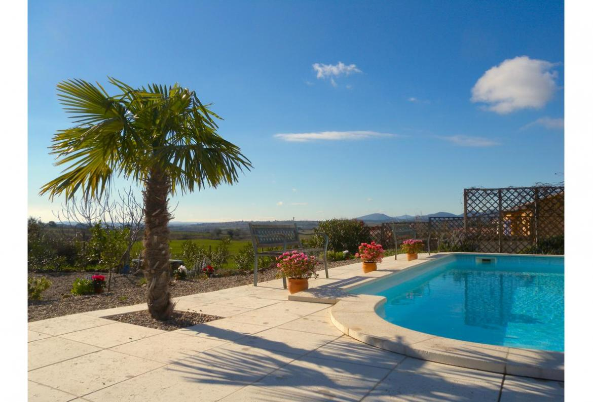 Beautiful family friendly villa boasting a private heated pool, 3 bedrooms, air-con, wifi and beautiful views. Sleeps 6. (LAUR105)