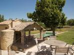Authentic Mas with 4 bedrooms located within walking distance of Bonnieux, boasting large grounds and a private swimming pool. Sleeps 8. (BONN107EE)