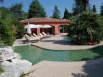 Beautiful 2 bedroom villa with a private garden and shared swimming pool on a residence. Sleeps 4-6 people (CARR104)