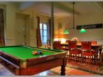 Grande House Games room Pool table darts dining room electricity box lights lamps fireplace non usable carpets windows to street shutters curtains tables Nissan entrance holiday rental languedoc