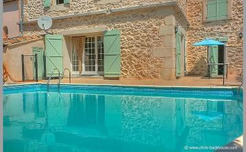 Private swimming pool big beautiful blue shutters decorated stylish french stone walls shade chairs table refreshing drinks terrace poilhes holiday rental languedoc herault village quite relaxing