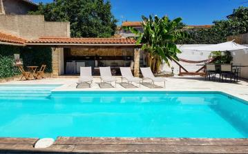 Beautiful 4 bedroom house in the centre of Sauvian with private heated pool and aircon, 10 minutes to beach, short walk to amenities. Sleeps 6 to 8. (SAUV106)